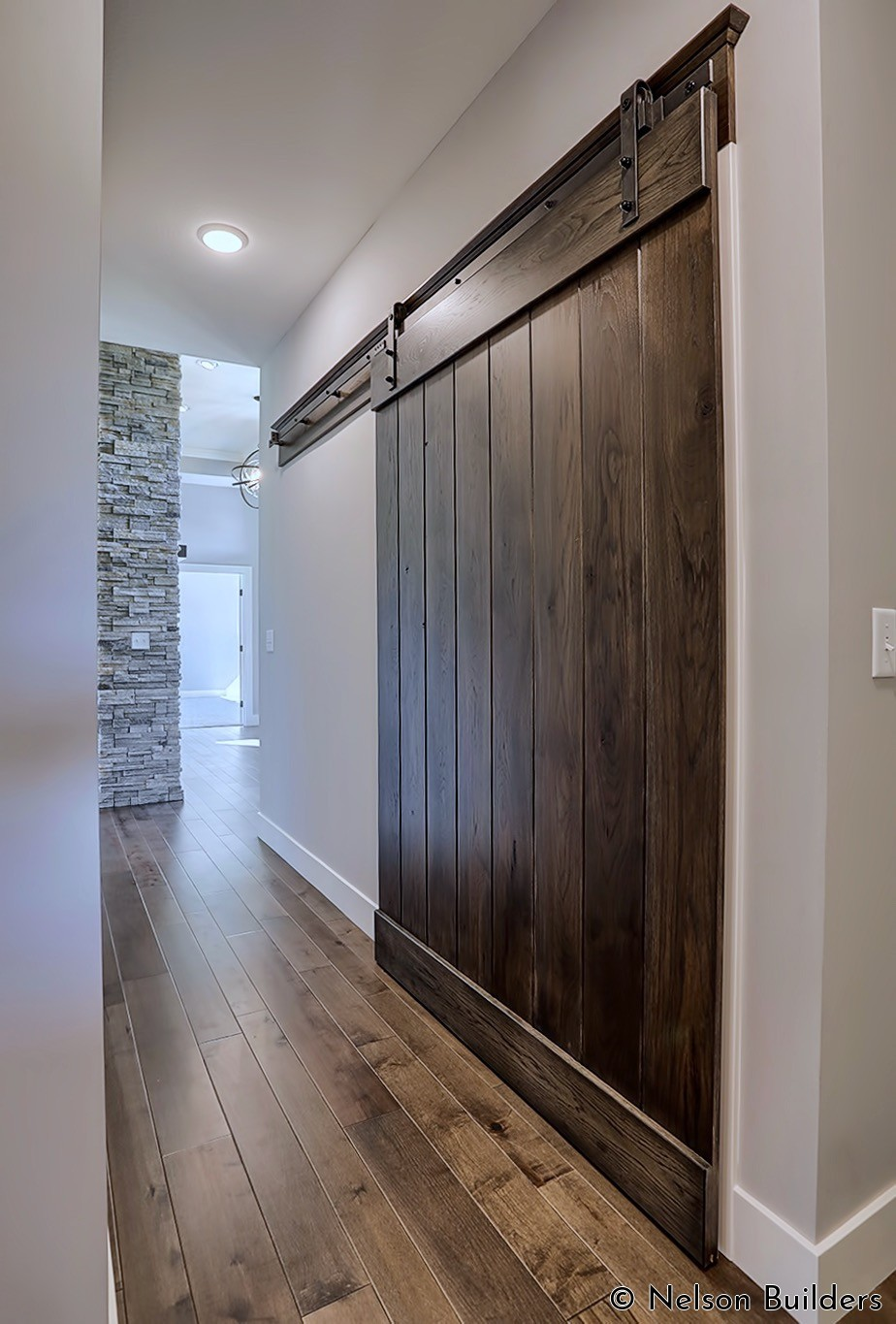 The massive barn door in the back hallway allows the cubbie area to be hidden if needed.