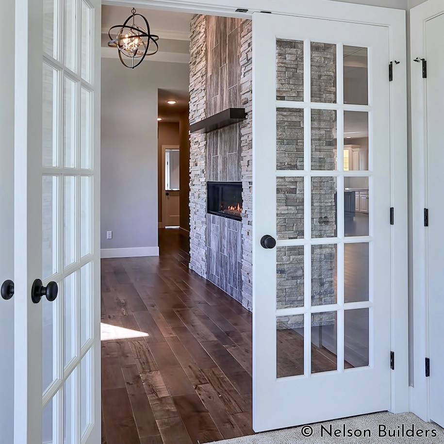 The glass French doors that lead from the front den add more light to the great room.