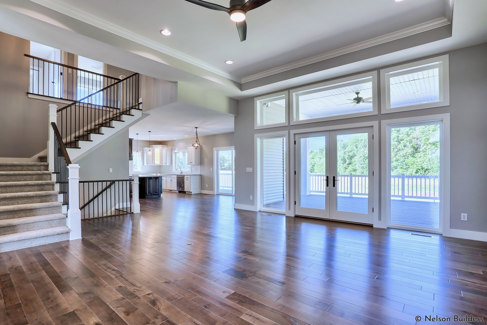 Even with a second floor above part of this home, the main living area feels open with the nearly 12-foot ceilings stretched from front to back.