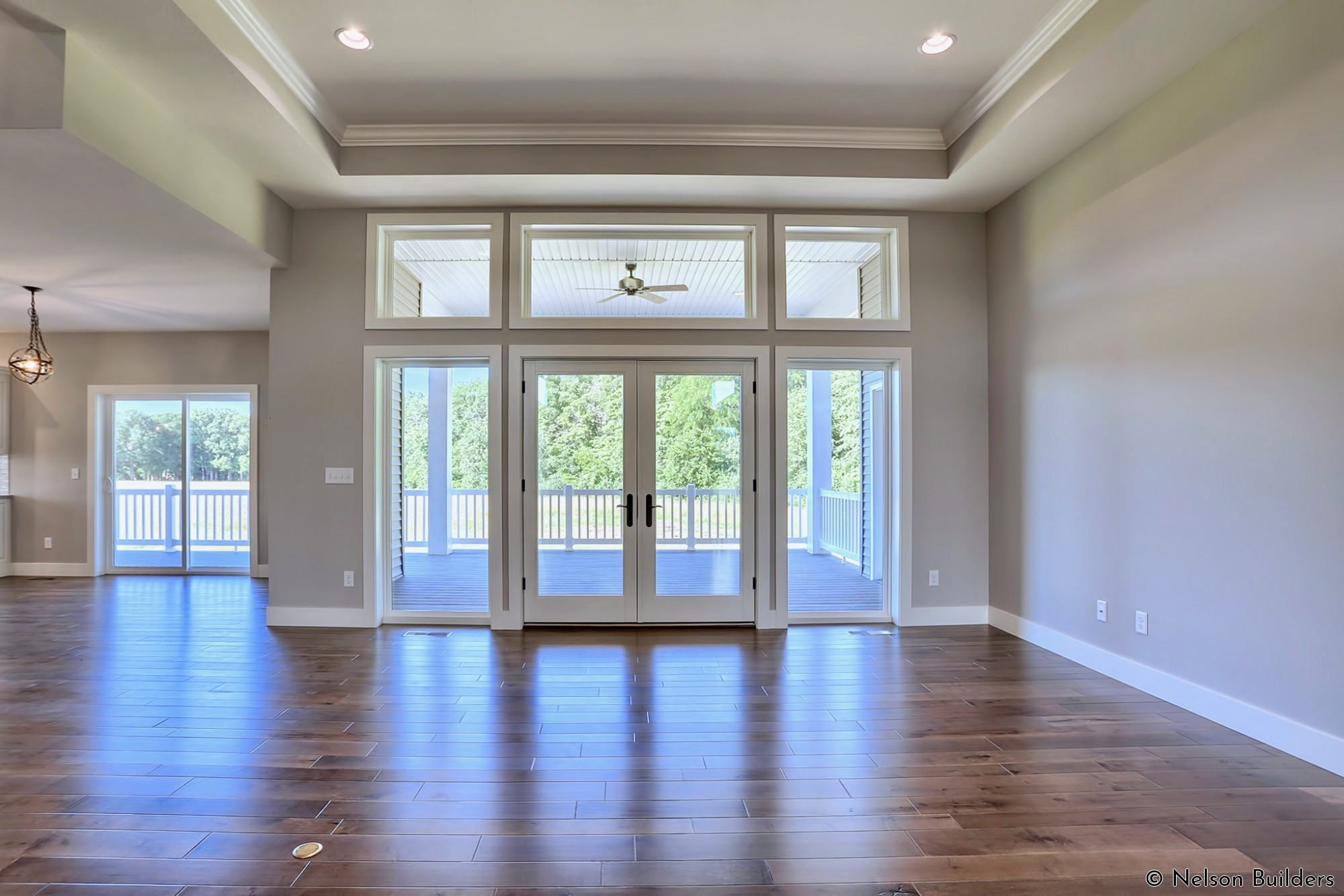 The abundance of transom windows on both the front and back allow for plenty of natural light, even with the large covered porch.