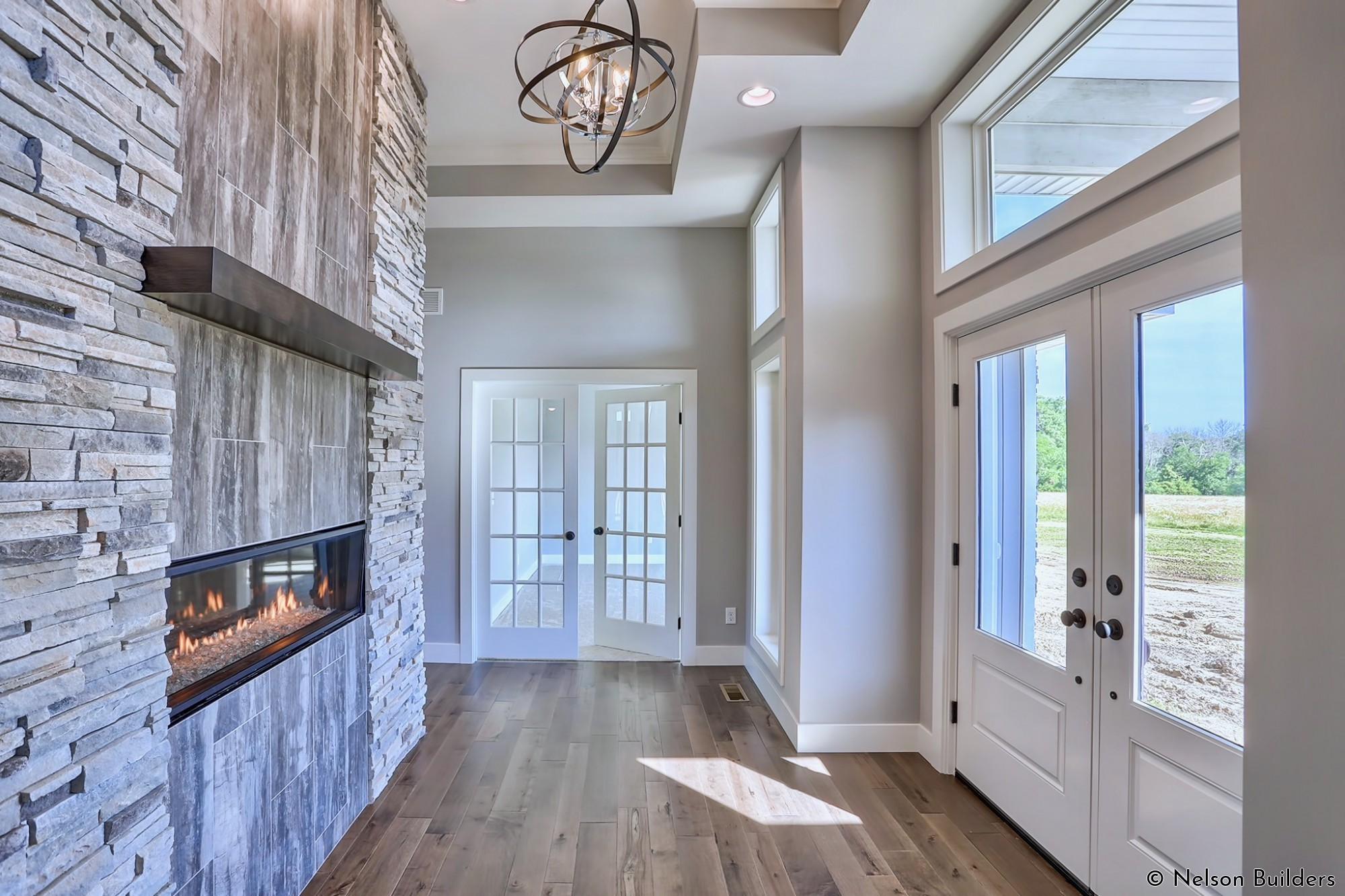 The fireplace is one of the main features of this home from the moment you walk into the glass-lined foyer.