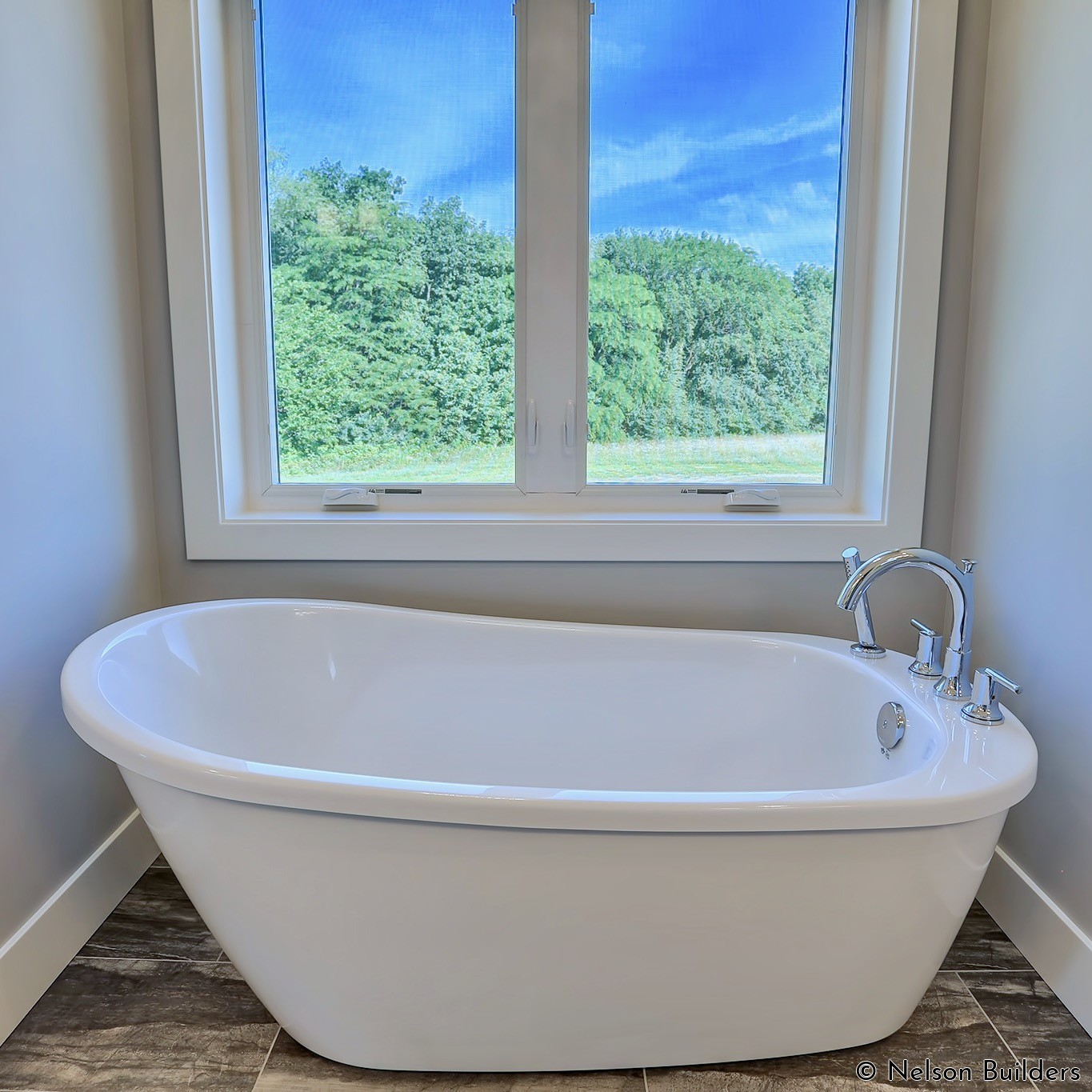 Even the master bathroom has a cozy spot to take in the views while enjoying a bath.