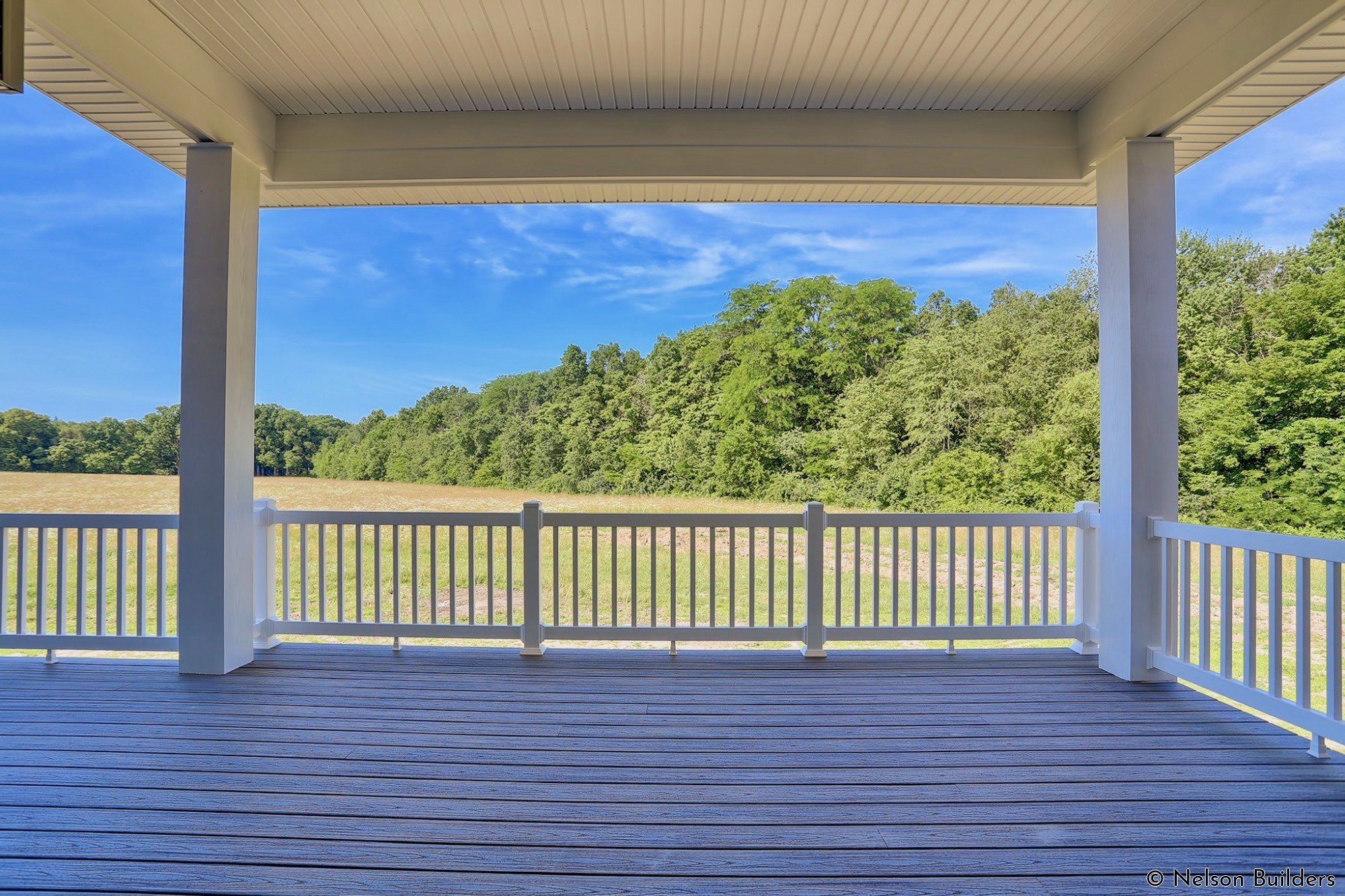 One of the best parts of this home is the view from the covered back deck.