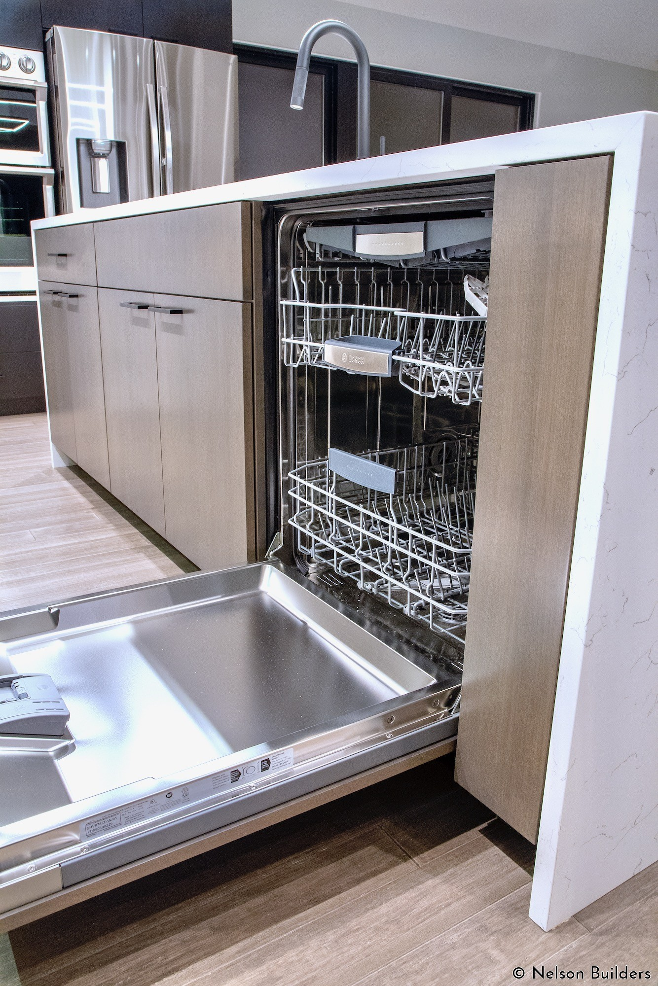 The panel front, integrated dishwasher is easily hidden in the island and blends in with the other millwork.