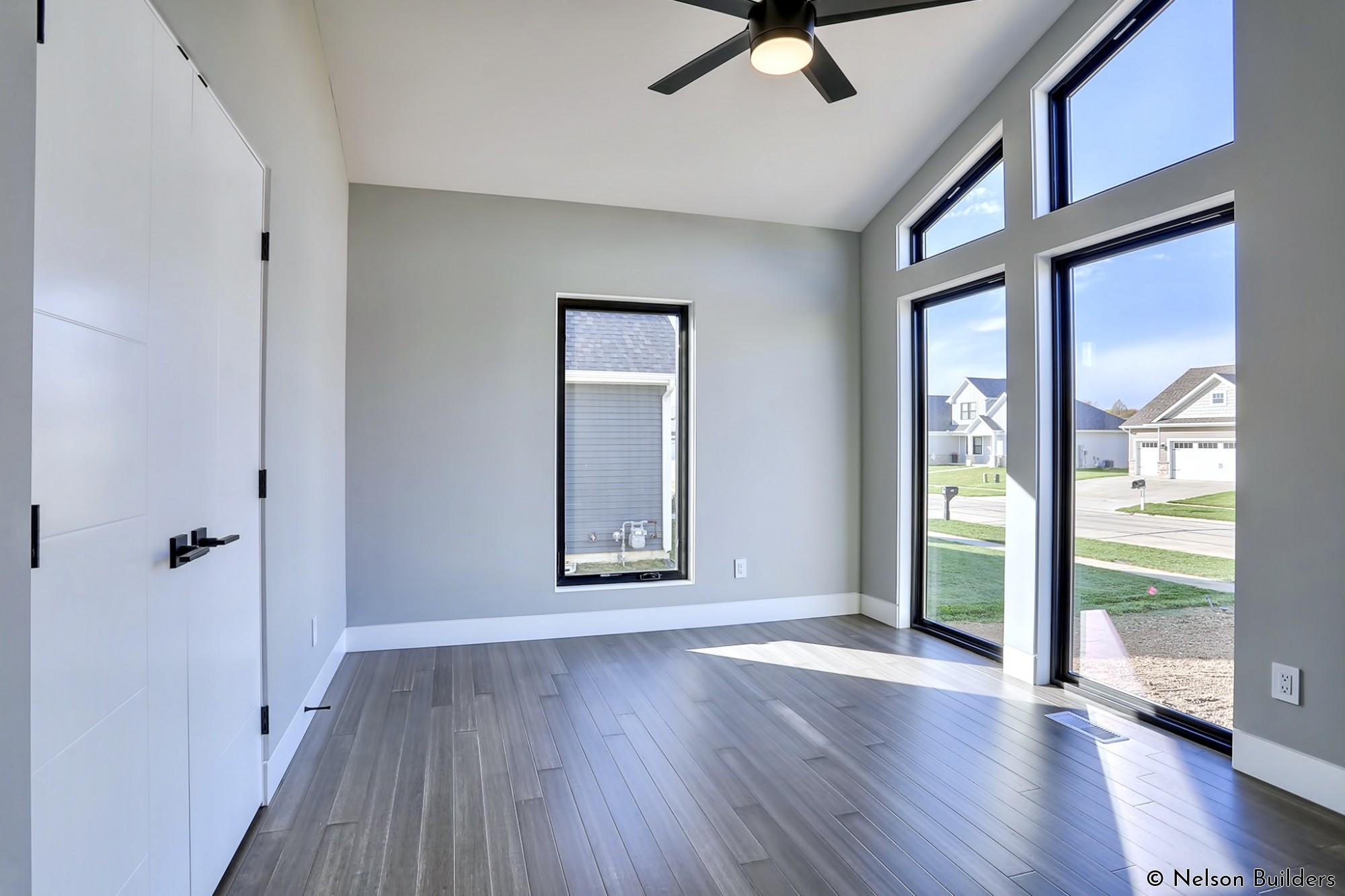 Just off the entry, the office overlooks the front yard and showcases the minimal window and door return details, along with the flush baseboard.