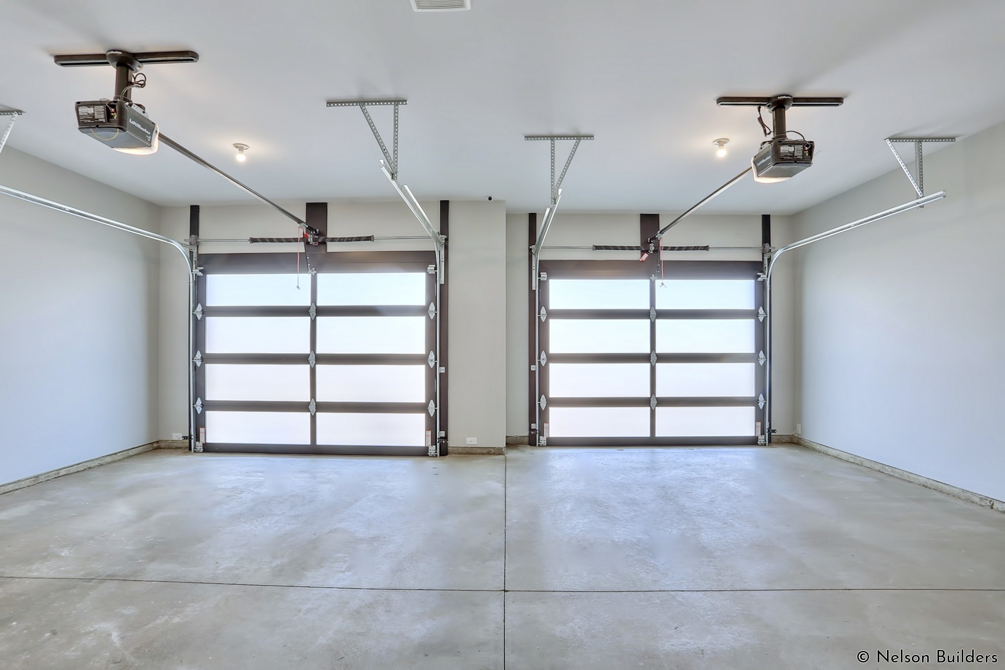 Not wanting to compromise on any space, the inside of the aluminum and glass garage doors were also wrapped in metal to give a clean, finished look.