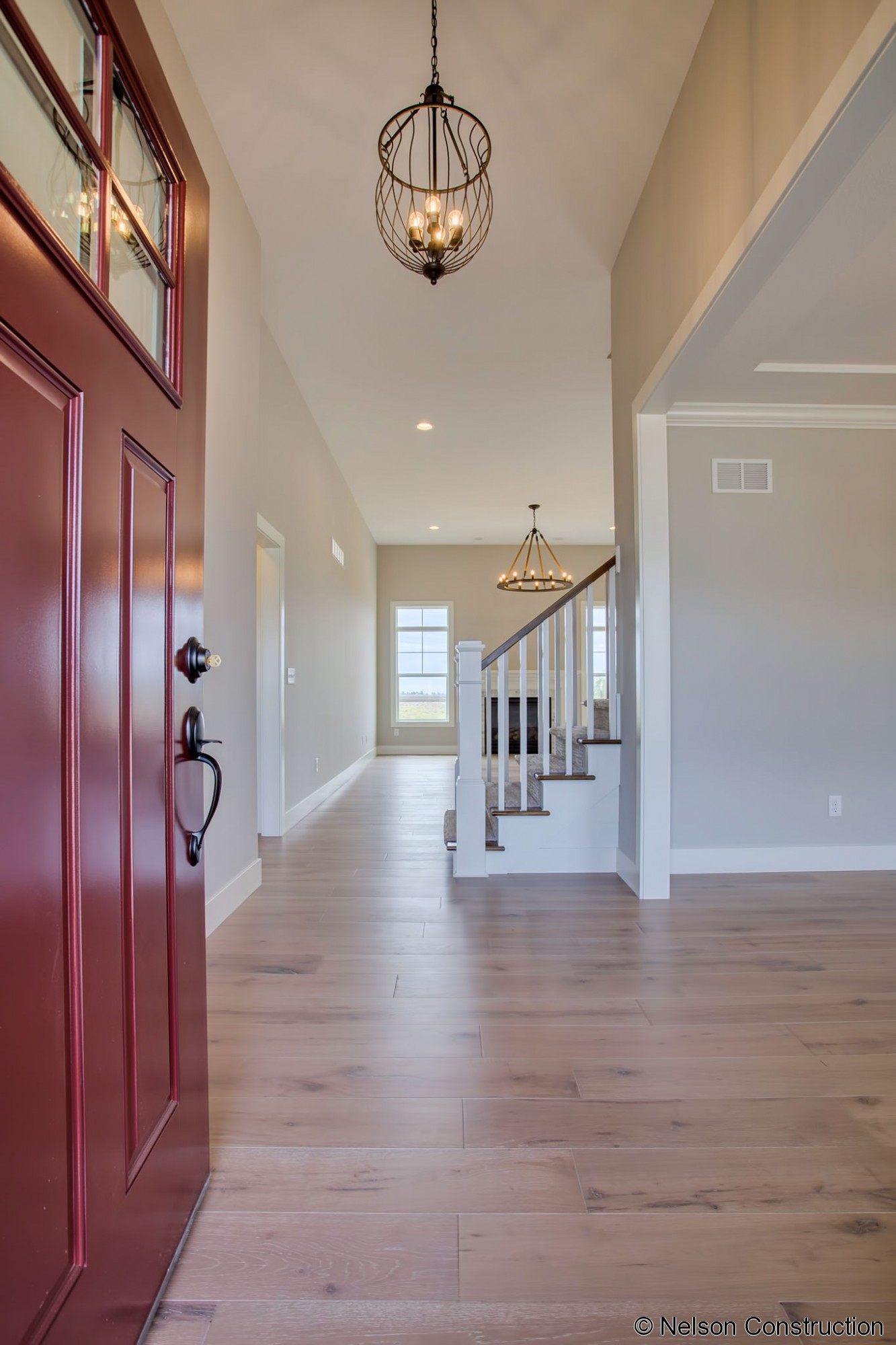 The foyer of this new home is light and airy with its transom windows, a welcome entrance to this new home.