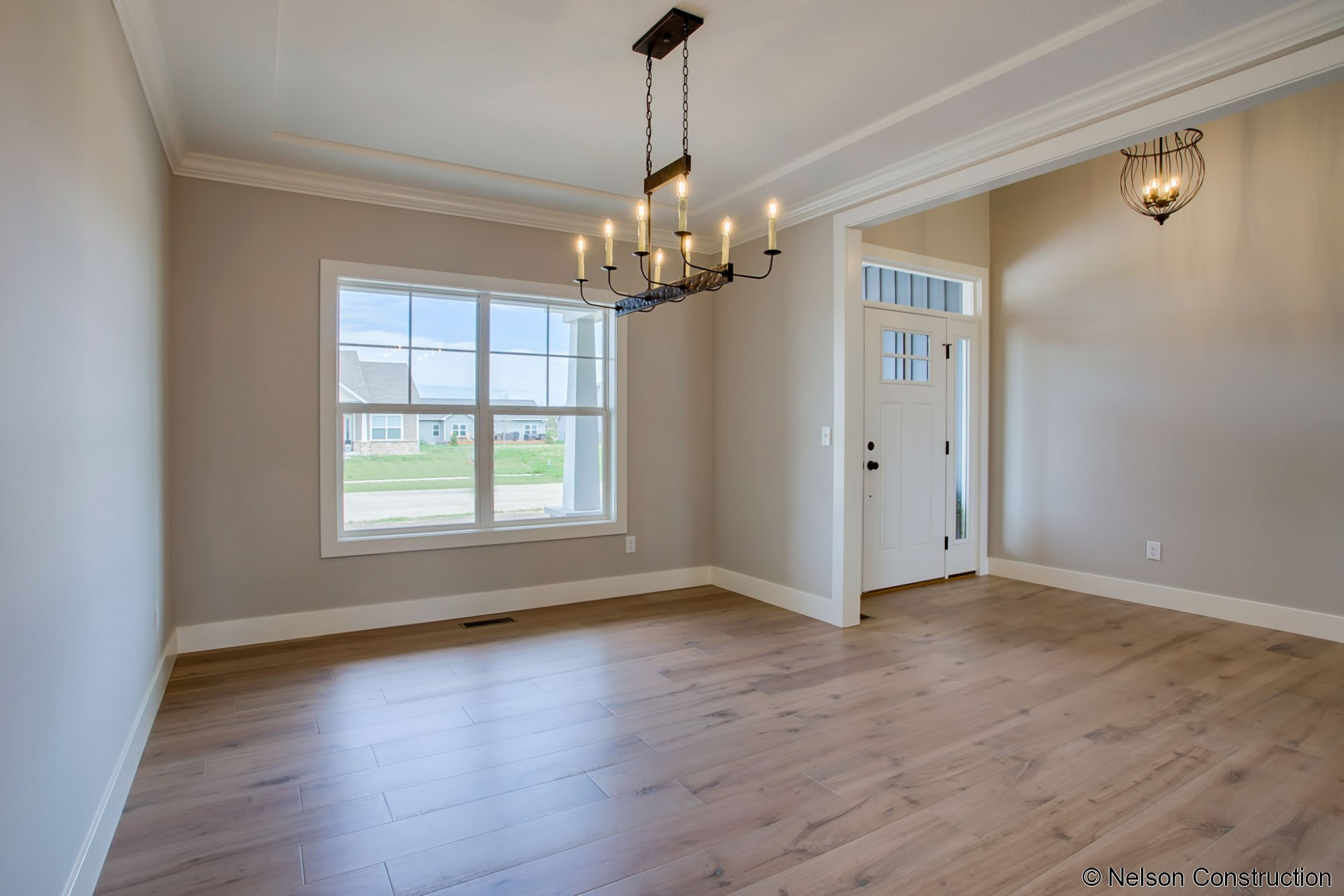 The dining room of this new Cherrydale plan features wire brushed wide plank flooring and opens to the foyer, bringing light into the space.