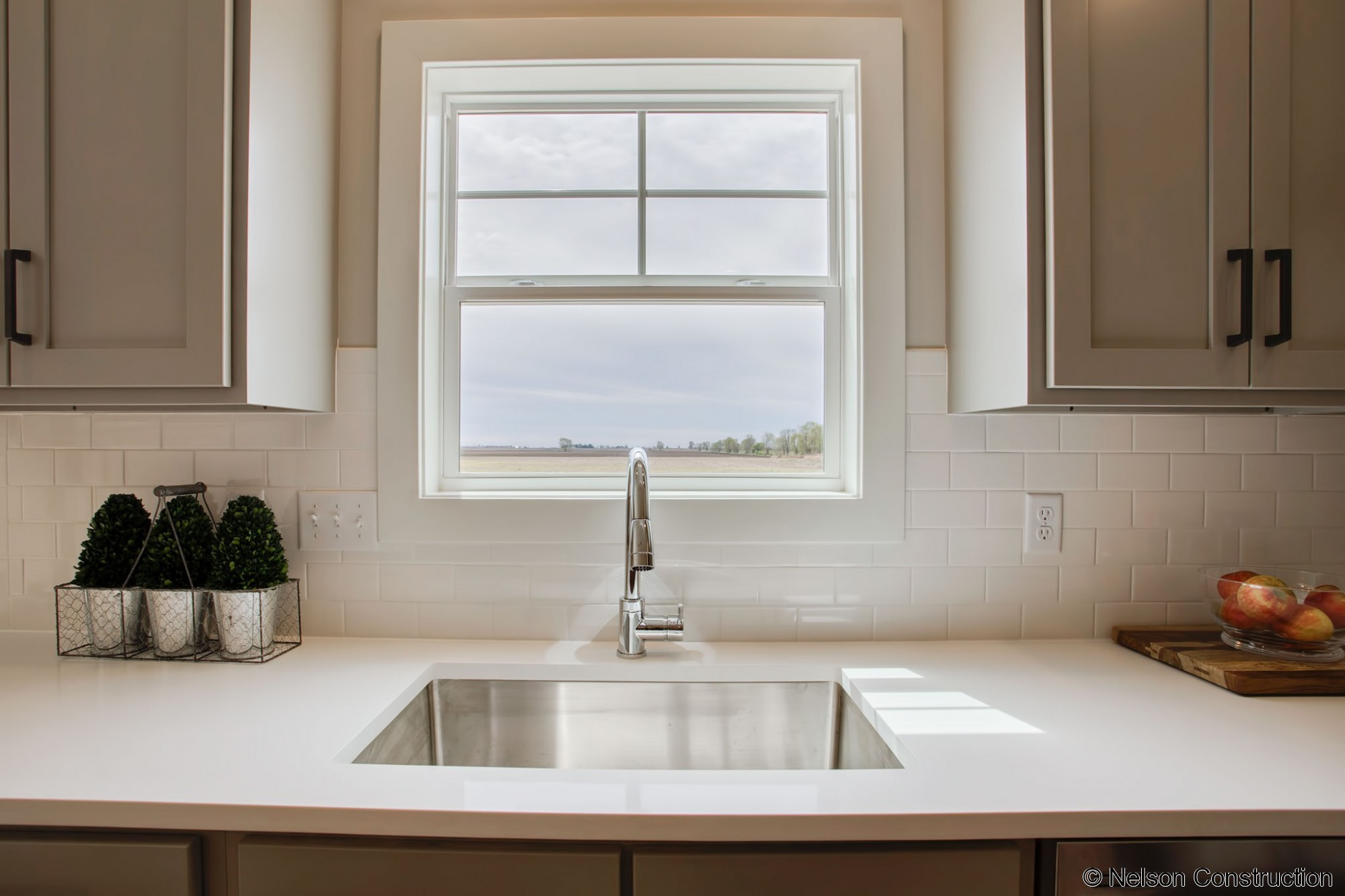 The kitchen sink of this new home by Nelson Builders overlooks the large back yard.