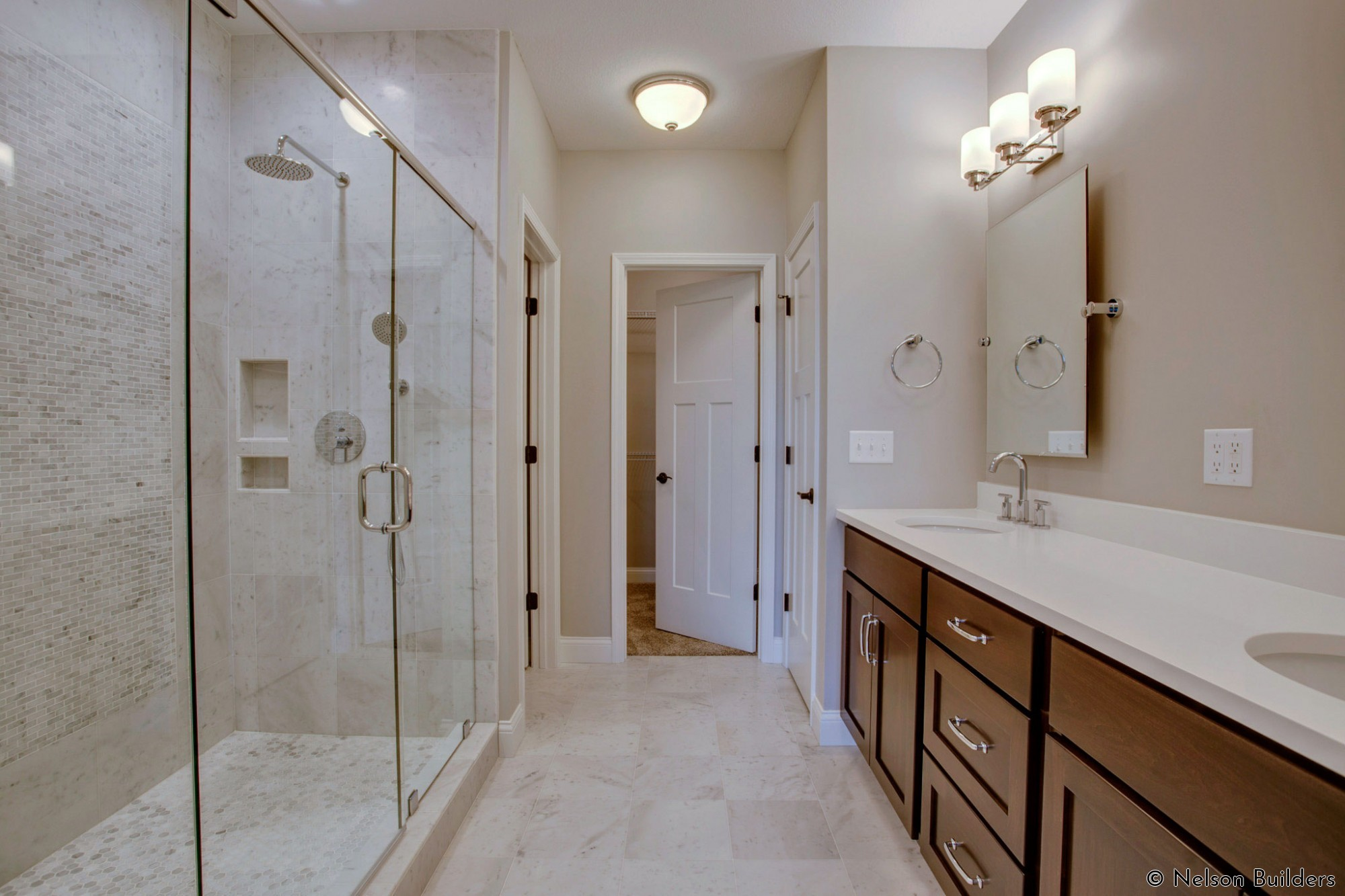 The beautiful, Carrara covered master bath and shower of this new Cherrydale plan by Nelson Builders.