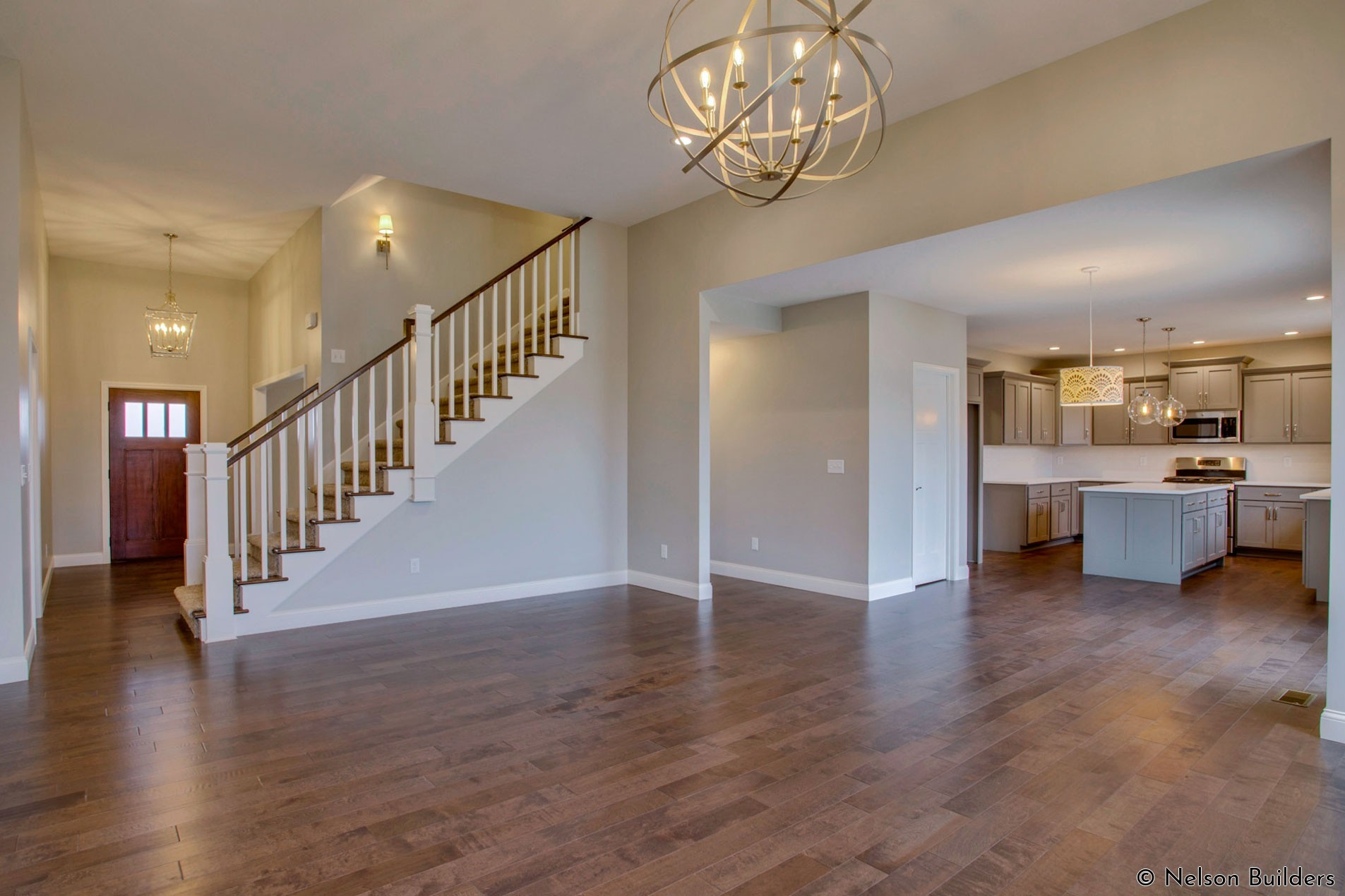 The wonderful open great room, kitchen, and foyer of this new Cherrydale plan by Nelson Builders.