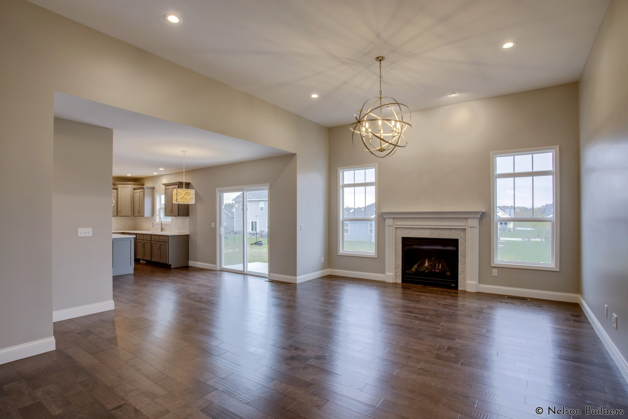 The wonderful open great room and kitchen of this new Cherrydale plan by Nelson Builders.